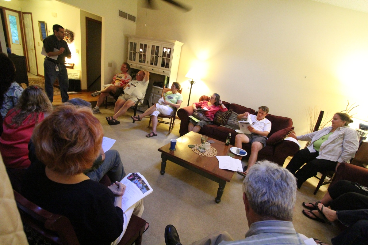 RPCVs listen to Peace Corps recruiter Douglas Miller during a monthly meeting.