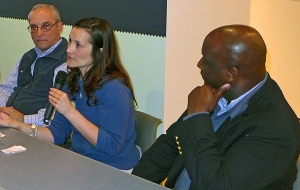 RPCV Stacey Thayer talks about her experiences in Togo while Daniel Lewicki (left) and Jermaine Privott (right) listen